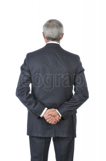 Standing Businessman with hands Behind Back