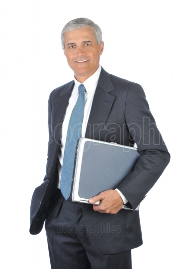 Standing Businessman with Laptop Computer