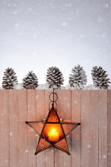 Star Lantern Hanging on Wood Fence