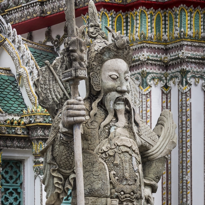 Statue of a Chinese warrior near an entrance of Wat Pho. Wat Pho