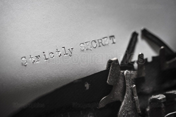 Strictly SECRET typed words on a Vintage Typewriter