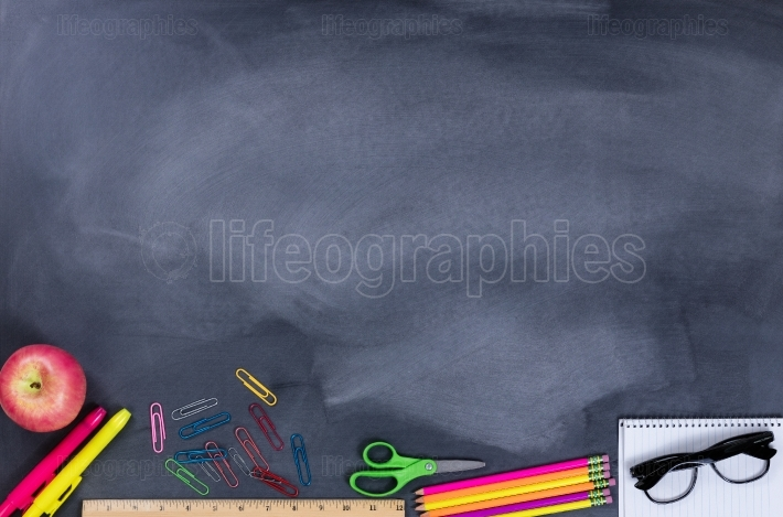 Student supplies on chalkboard