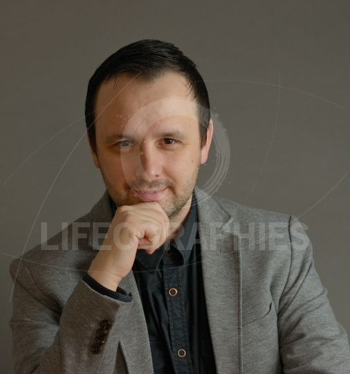 Successful businessman. Portrait of confident young man looking at camera and smiling