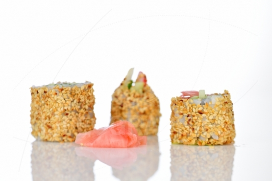 Sushi rolls with sesame seeds