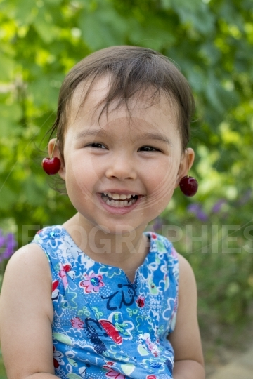 Sweet little girl with cherry earrings