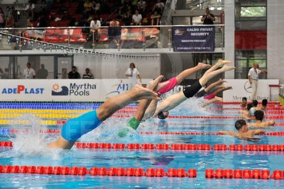Swimmers competing in Dinamo pool