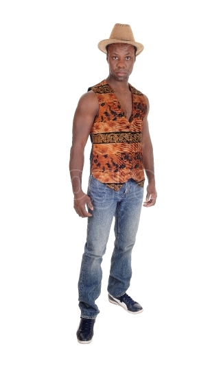 Tall African man standing in vest and jeans