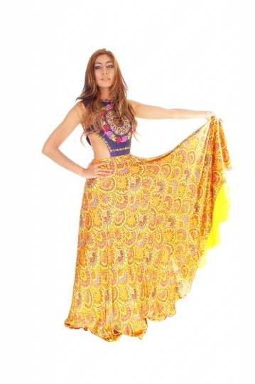 Tall young woman in yellow skirt.