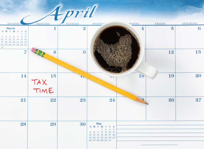 Tax due date marked in red on calendar with coffee drink