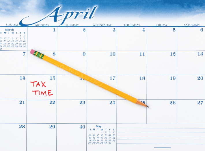Tax due date marked in red on calendar with pencil