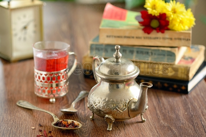 Tea cup and old fashioned silver teapot