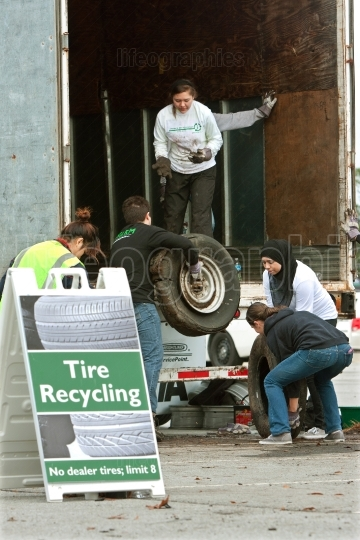 Teen Volunteers Collect Worn Tires At Recycling Event
