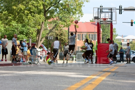 Teenage Boys Compete In Asphalt Basketball Tournament On City St