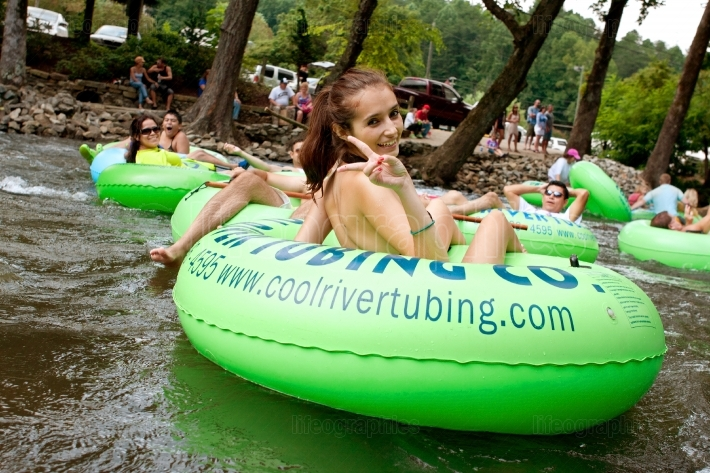 Teenage Girl Flashes Peace Sign While Tubing Down Georgia River
