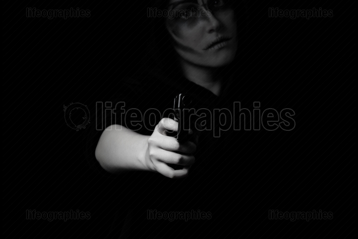 Teenage girl holding weapon at night time