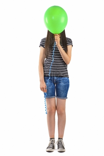 Teenager girl with balloon cover her face