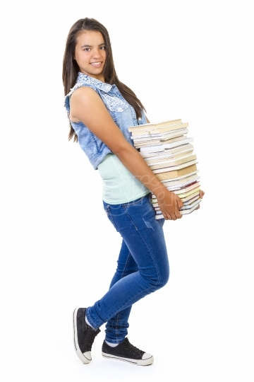 Teenager girl with stack of books isolated over white