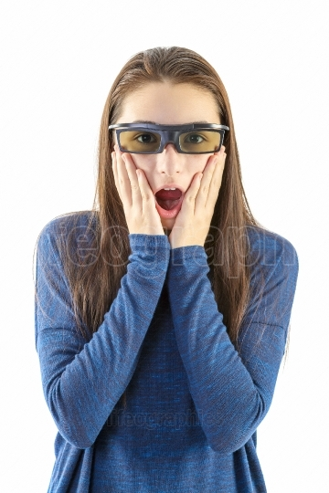 Teenager watching a 3D movie with 3D glasses