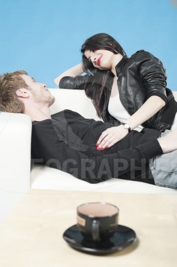 Teens lying on the couch, talking laughing happily