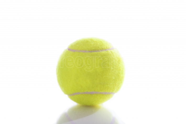 Tennis ball isolated on pure white background with reflection