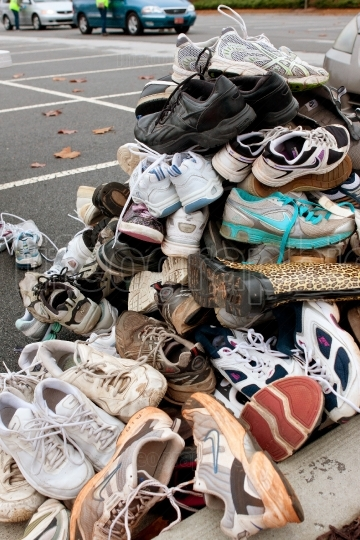 Tennis Shoes Sit Piled High To Be Recycled