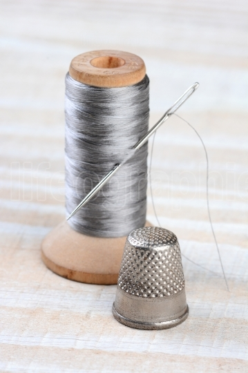 Thimble and Thread Spool