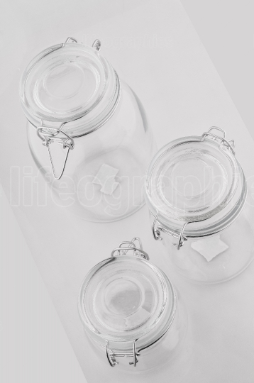 Three empty glass jars