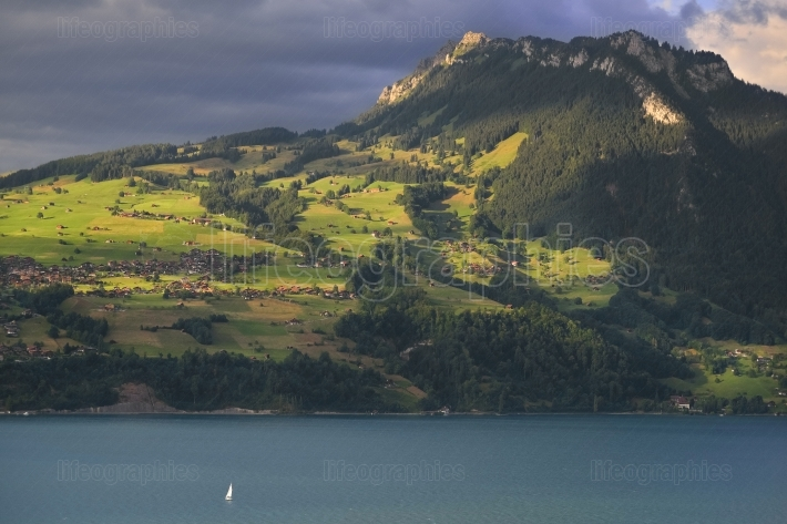 Thunersee lake with boat. switzerland.