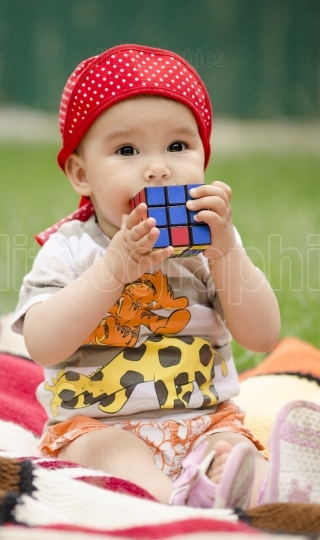Toddler playing with a cube