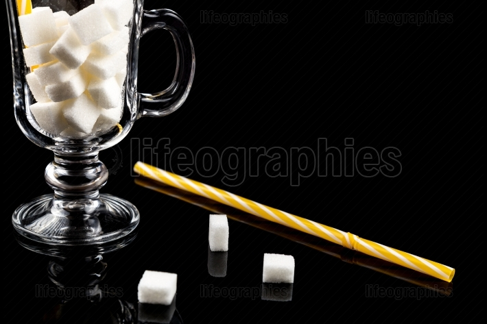 Too much sugar  Cubes of sugar in the glass   Concept of unhealt
