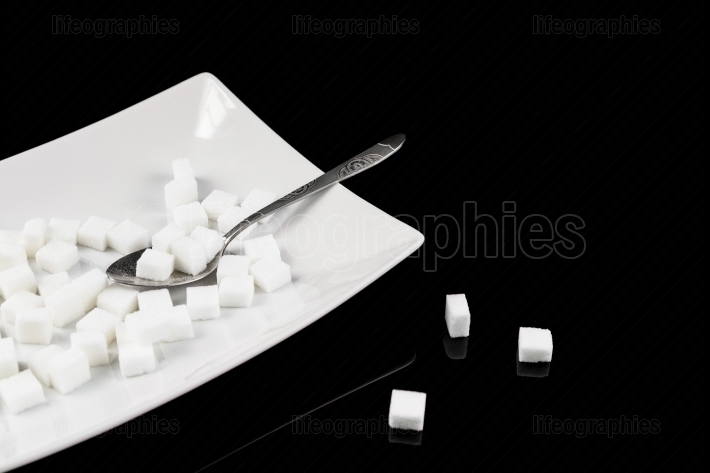 Too much sugar  Cubes of sugar in the plate   Concept of unhealt