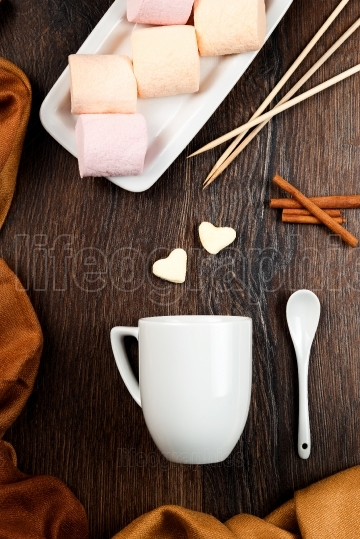 Top view of drink hot chocolate with marshmallow and cinnamon on