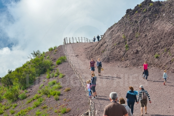 Tourists climbing mount vesuvius, in naples, italy