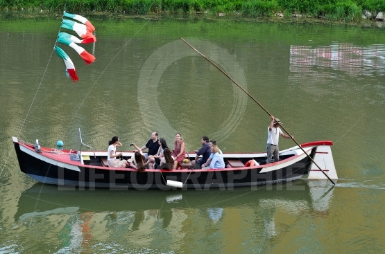 Tourists on boat ride on arno river