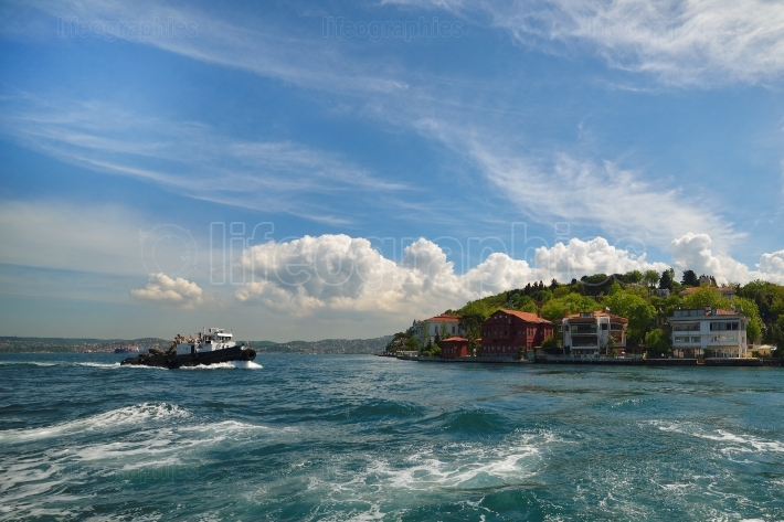 Towing boat towards Istanbul small port on the Bosporus channel, Istanbul, Turkey