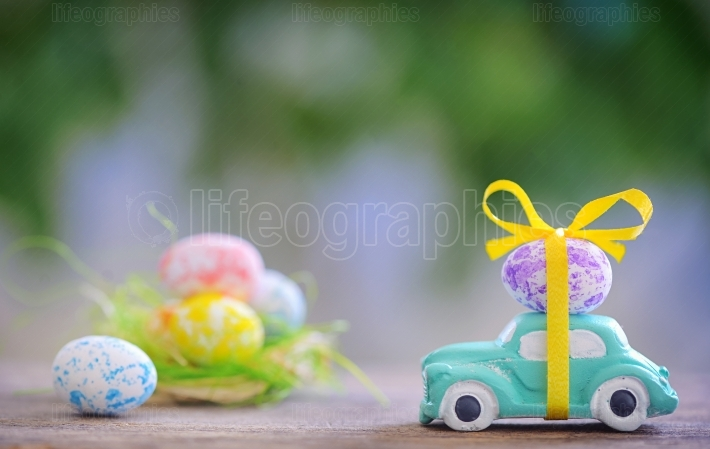 Toy car carrying easter egg