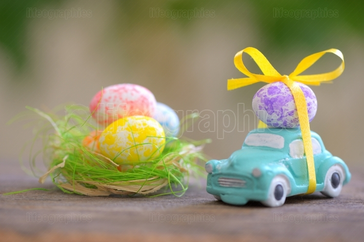 Toy car carrying easter eggs