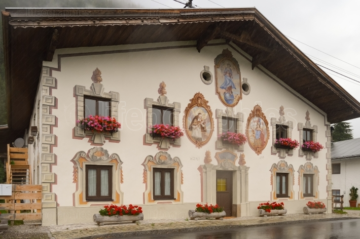 Traditional architecture in the Austrian Tyrol with paintings on