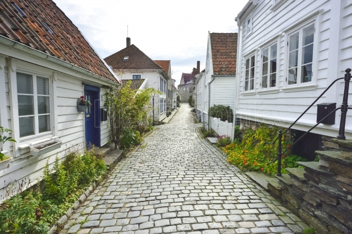 traditional cobblestone street with wooden houses in the old town of Stavanger, Norway