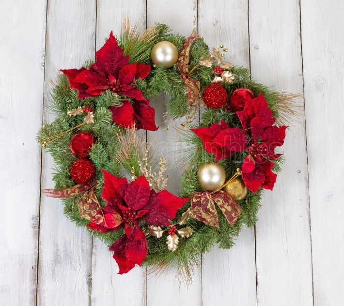 Traditional holiday Christmas wreath on rustic white wooden boar