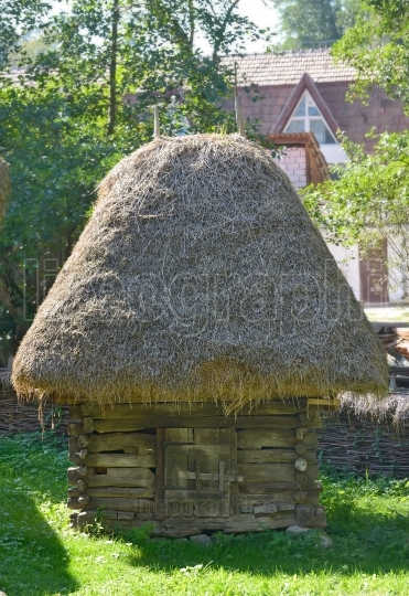 Traditional romanian barn with straw roof