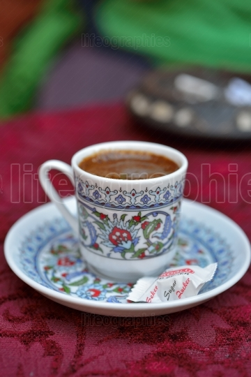 Traditional turkish cup of coffe on table