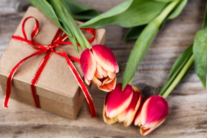 Tulips on top of boxed gift