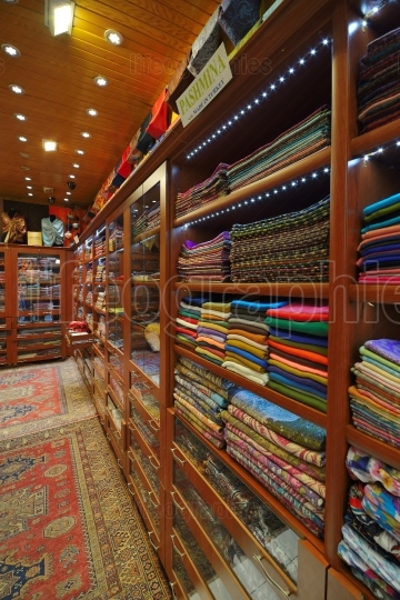 Turkey, Istanbul, Grand Bazaar (Kapali Carsi), pashmina and silk scarfs for sale.