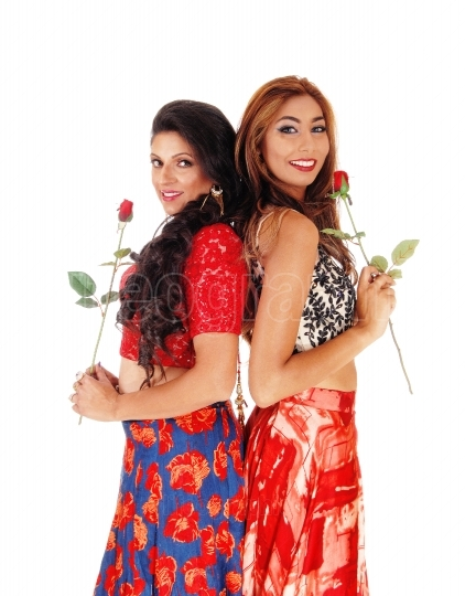 Two beautiful woman holding a rose.