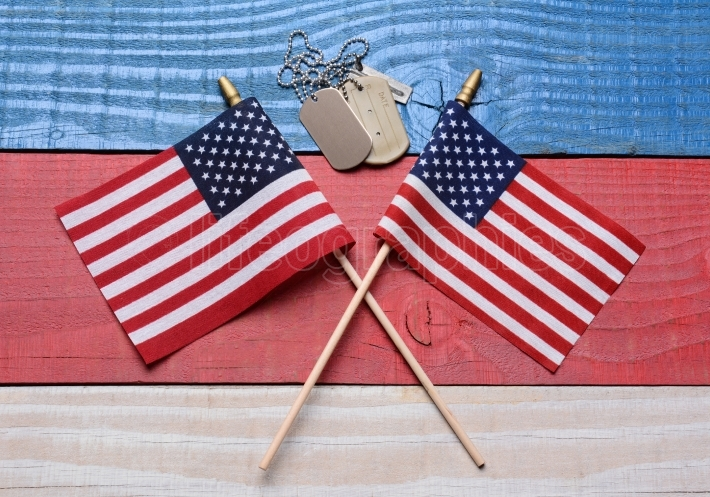 Two Flags and Dog Tags on Patriotic Table