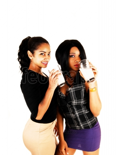Two girls drinking Milk