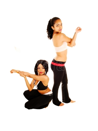 Two girls stretching