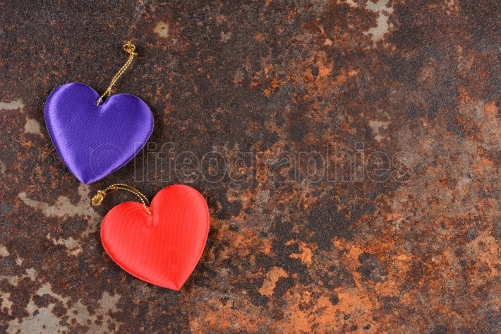 Two Hearts On Rusty Metal Background