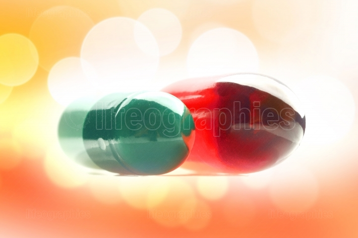 Two pills with vitamins
